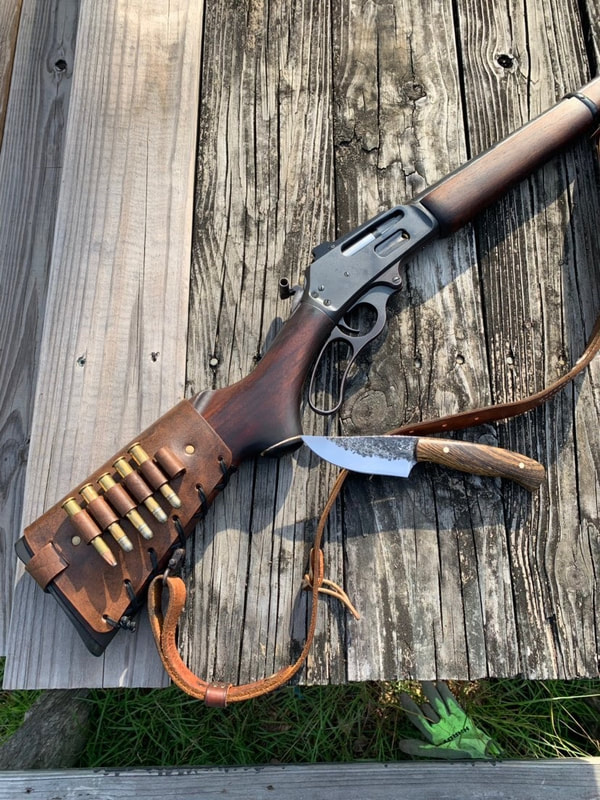 Marlin 336 lever action with Antique Crown Cartridge Cuff buttstock shell holder and leather rifle sling